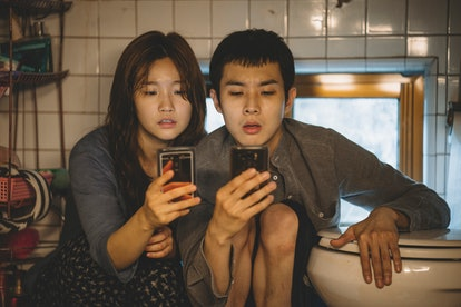 Ki-jung Kim (So-dam Park) and Ki-woo Park (Woo-sik Choi) in Parasite