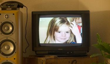 A photo of British girl Madeleine McCann aka Maddie is displayed on a TV screen.