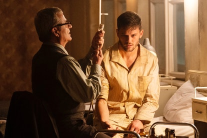 J. Randolph Bentley (Jeremy Irvine) encounters Dr. Meisner (Martin Umbash) in USA's 'Treadstone.'