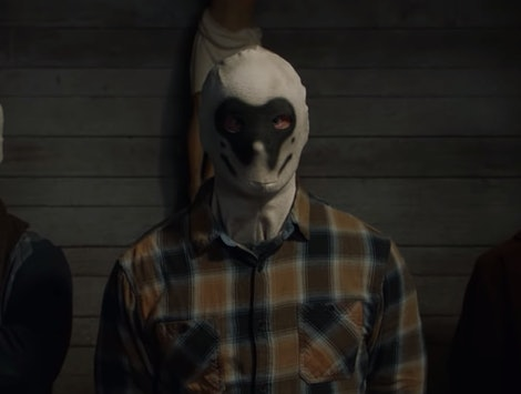 pictures of men with a Rorschach masks in the Watchmen trailer