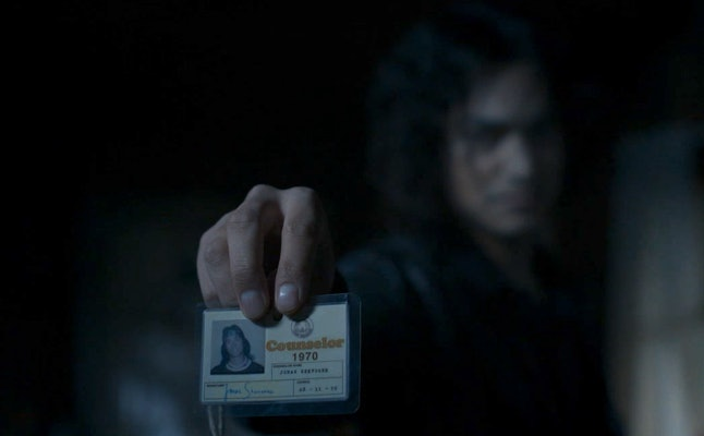 Zach Villa as Night Stalker Richard Ramirez holding the Hitchhiker's ID in 'AHS: 1984'
