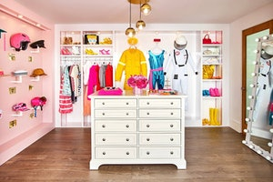 The walk-in closet of Airbnb's Barbie Malibu Dreamhouse has outfits from all of Barbie's many careers.