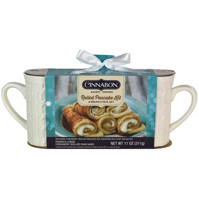 The Cinnabon Rolled Pancake Kit comes with pancake mix, hot cocoa mix, icing mix, and two mugs.