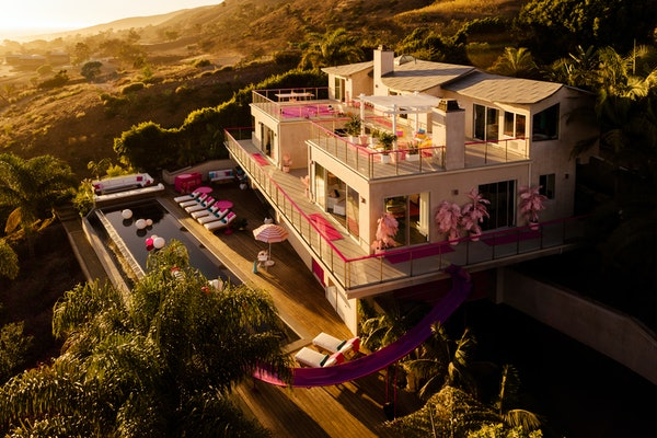 The exterior of Barbie's Malibu Dreamhouse is painted golden during a Californian sunset.
