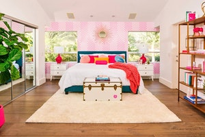 The master bedroom of the Barbie Malibu Dreamhouse on Airbnb is the perfect place to unwind.