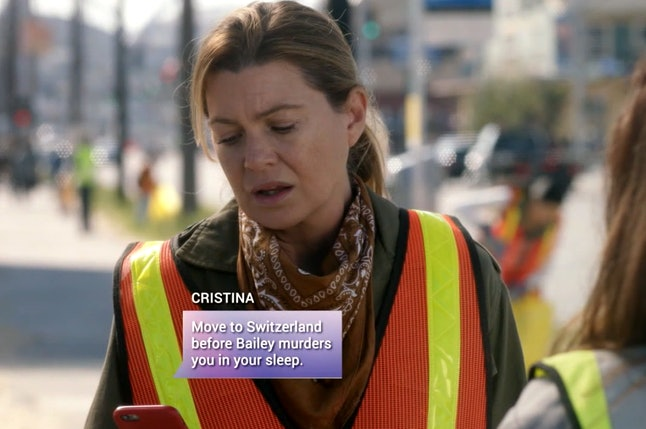 Ellen Pompeo as Meredith Grey reads a text from Sandra Oh's Cristina Yang in Grey's Anatomy