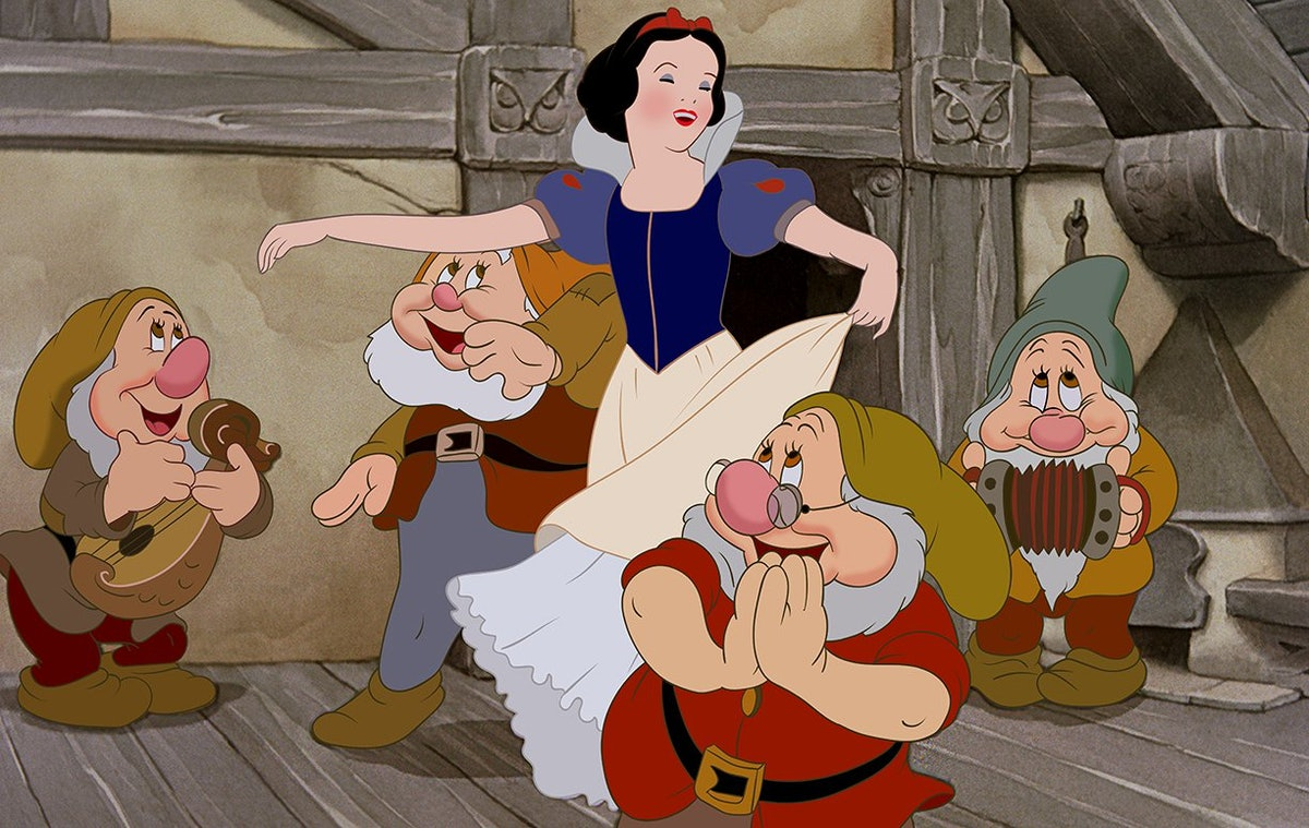A scene from 'Snow White and the Seven Dwarfs' with Snow White and the seven Dwarfs dancing, which would make a great Disney group costume for Halloween.