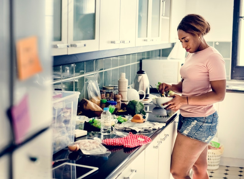 A person prepares a brain-food rich lunch at their kitchen counter