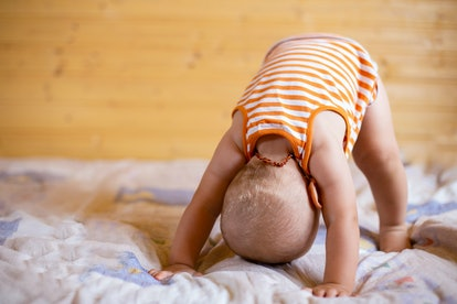 Toddlers stand on their heads to explore their world, experts say.