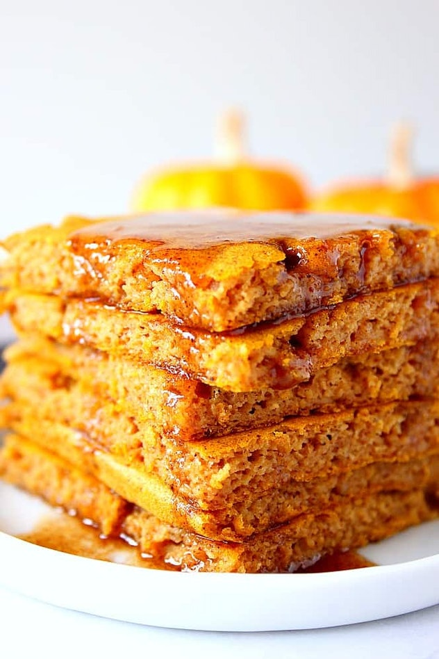 These pumpkin sheet pan pancakes add a Halloween touch to breakfast.