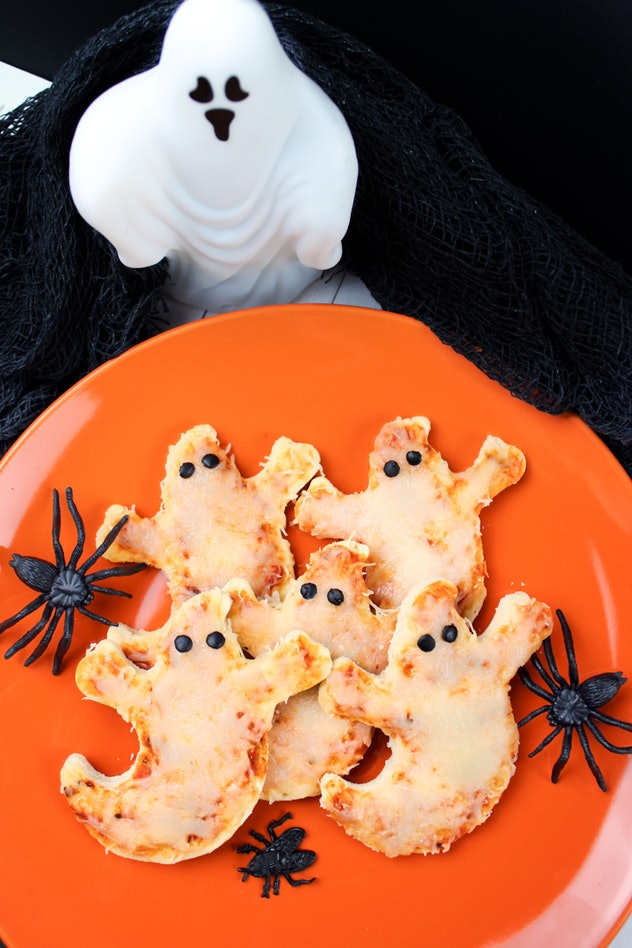 Halloween mini pizzas are even more fun when you cut them into spooky shapes.