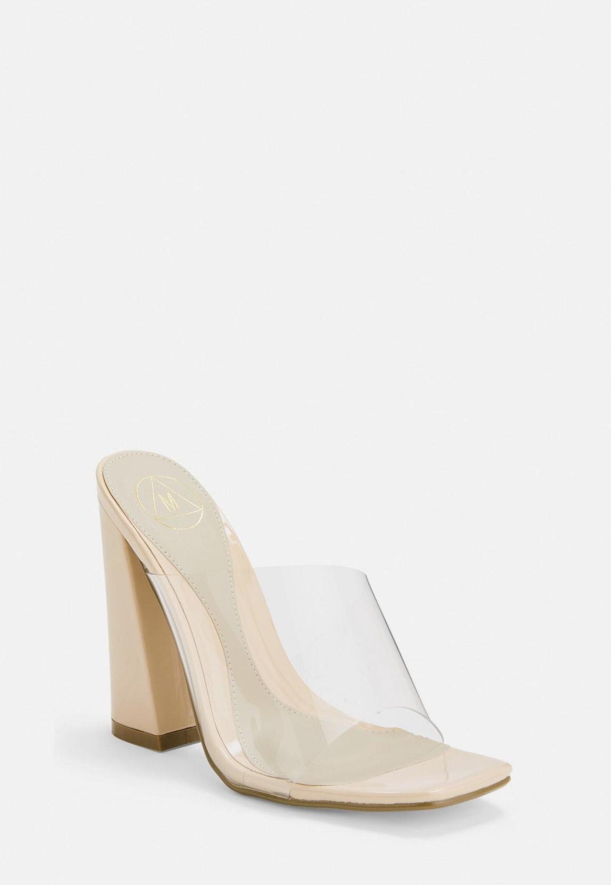 Nude Asymmetric Clear Flared Heel Mules