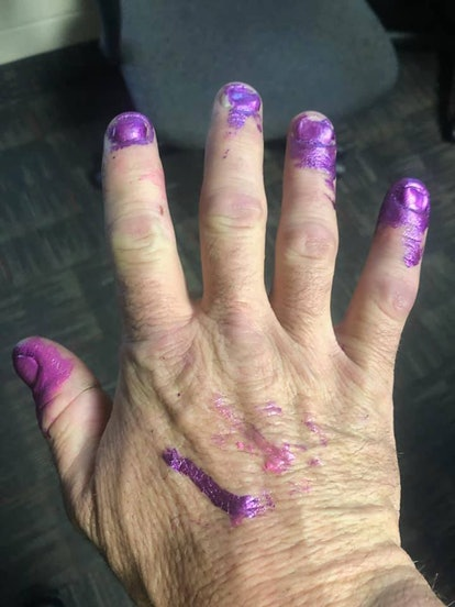 Firefighters let a toddler paint their nails after a car crash.
