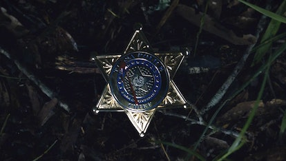 Chief Judd Crawford's badge with blood splattered on it from Watchmen