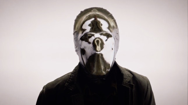 Looking Glass's mask reflects a Rorschach symbol while interrogating a pilot in HBO's Watchmen.