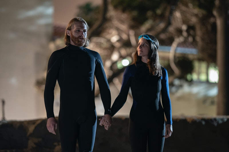 Dud (Wyatt Russell) and Liz (Sonya Cassidy) hold hands in the Season 2 finale of 'Lodge 49.'