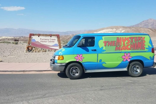 The Mystery Machine from 'Scooby-Doo' sits in the desert and is available to rent on Turo for Halloween.