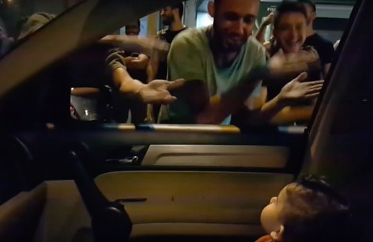 """A group of demonstrators sing """"Baby Shark"""" to a toddler stuck in traffic amid protests in Lebanon."""