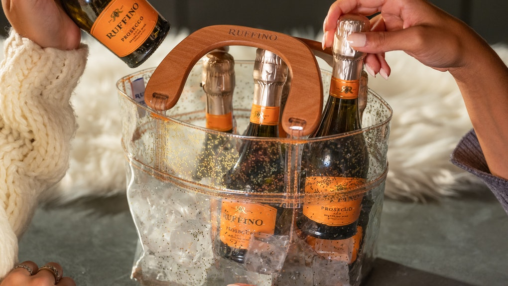 The Ruffino Prosecco Holiday Six-Pack comes in a festive sparkly purse.