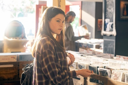 Teenage Kate in This Is Us broswing a CD store