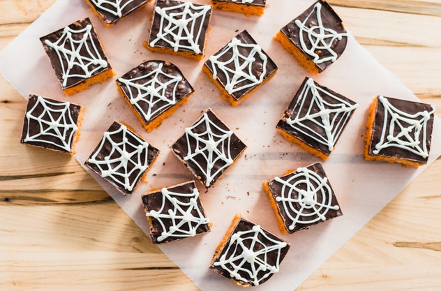 Spiderweb rice cereal treats make a spooky Halloween snack for the classroom.