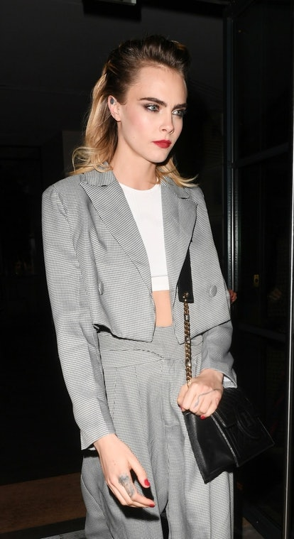 Cara Delevingne's half-up hairstyle is an edgy update that's perfect for parties.