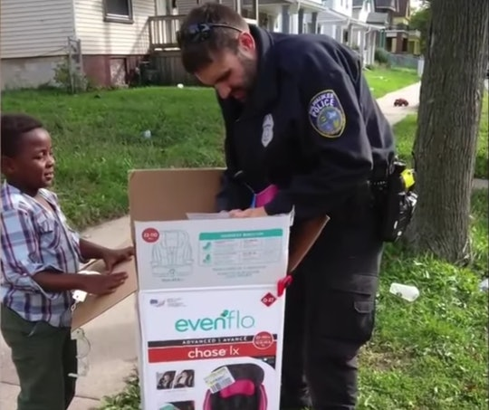 A Milwaukee police officer bought car seats for a mom who was unable to afford them herself.