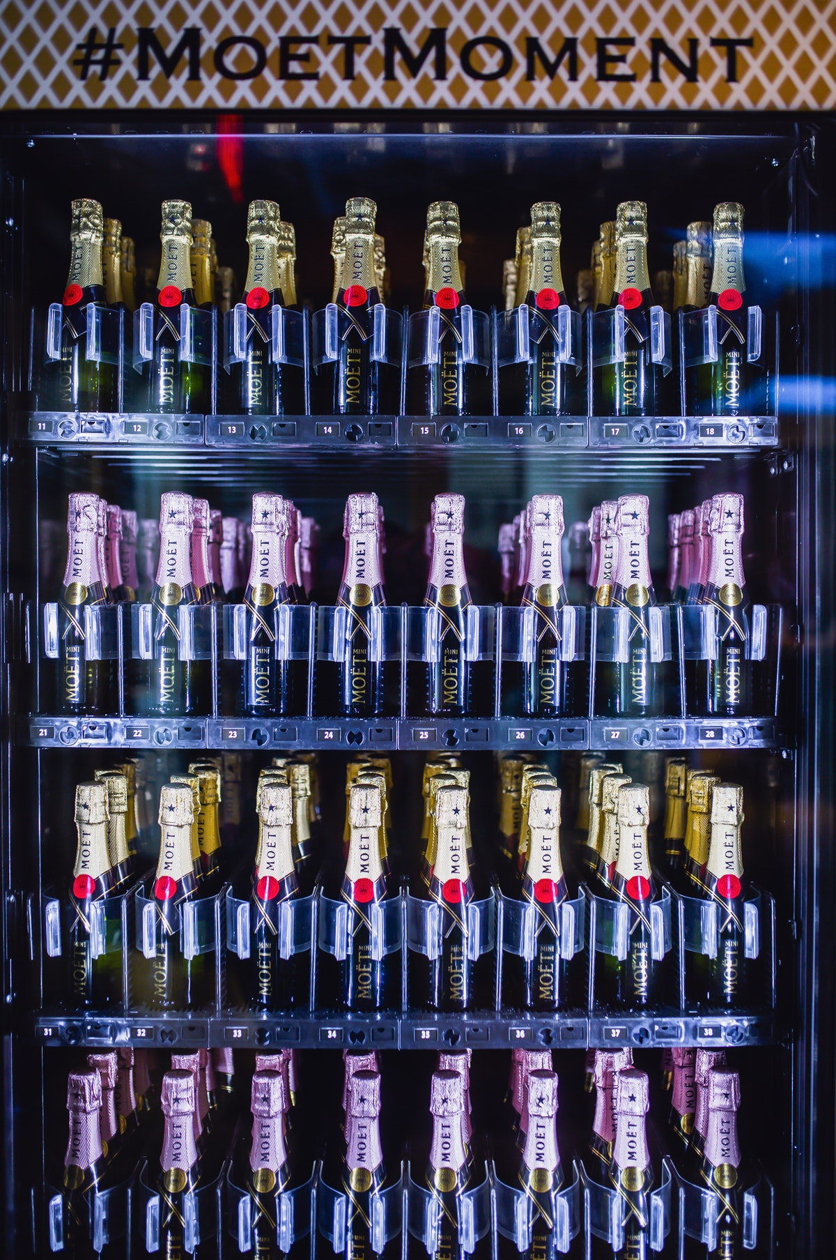 Bottles of Moët & Chandon Champagne are in a vending machine in The Lexington Hotel in New York City.