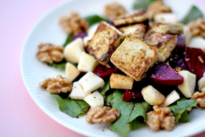 A salad with walnuts, apples, and beets. Eliminating meat from your diet can alter your genetic material.