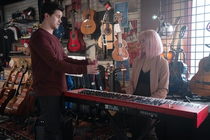 Eric and Maggie from A Million Little Things in Eric's music shop