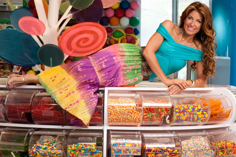 Dylan Lauren on top of candy at Dylan's Candy Bar