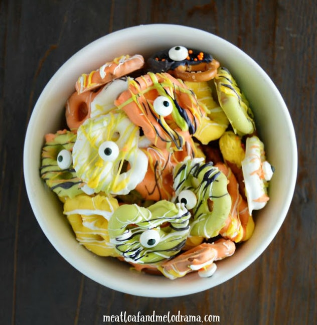 Orange, yellow, and green candy-coated pretzels are perfect Halloween snacks for the classroom.