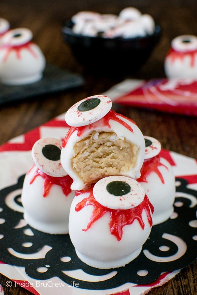 Peanut butter zombie eyeballs are a no-bake Halloween snack for the classroom.