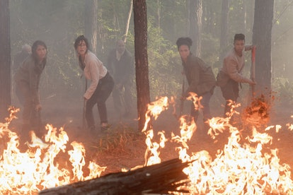 The Walking Dead cast puts out a fire caused by a satellite
