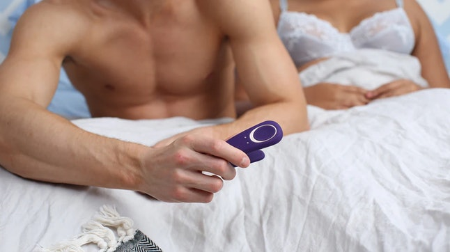 A couple gets ready to use a sex toy together.