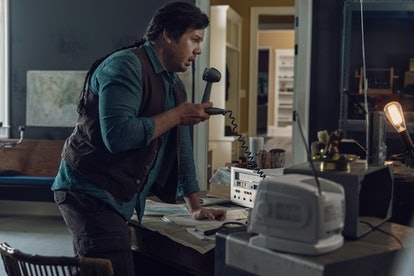 Eugene using his radio on The Walking Dead