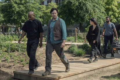 Eugene on a mission with the cast of The Walking Dead