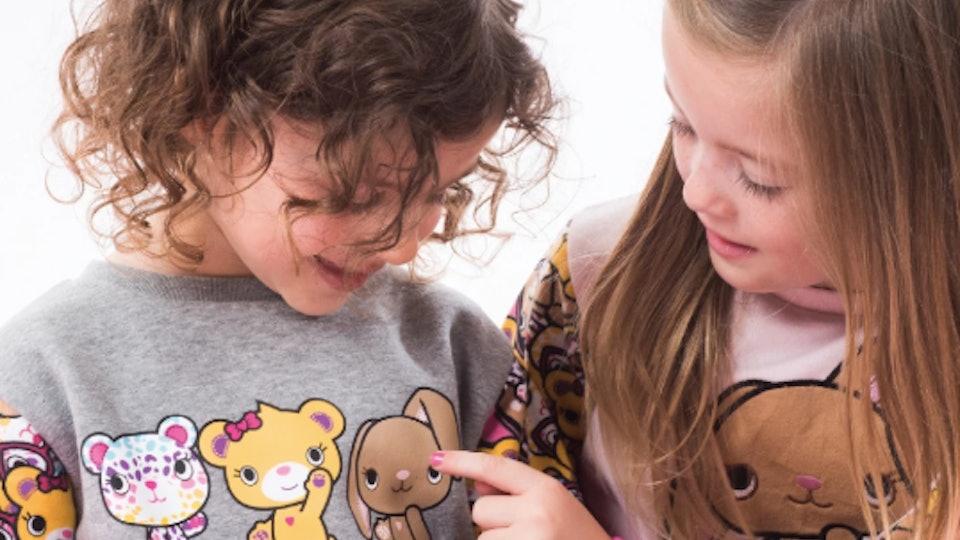 Two girls in Build-A-Bear Apparel Sweatshirts