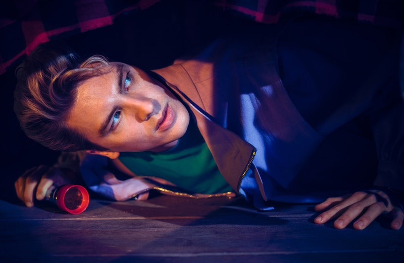 Xavier, played by Cody Fern, is trapped in Camp Redwood on AHS: 1984