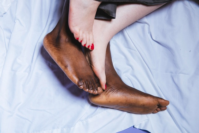 The feet of a man and woman having sex. Pain during sex is most common women in heterosexual relationships.