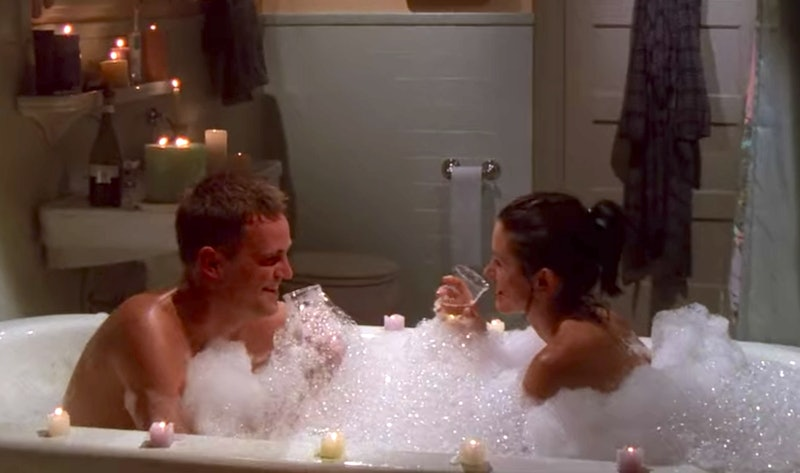 Chandler and Monica in the bath with candles