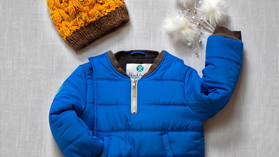 A car seat coat and hat from Buckle Me Baby