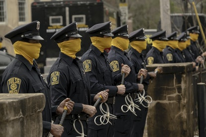Masked police officers under the Redford administration in Watchmen