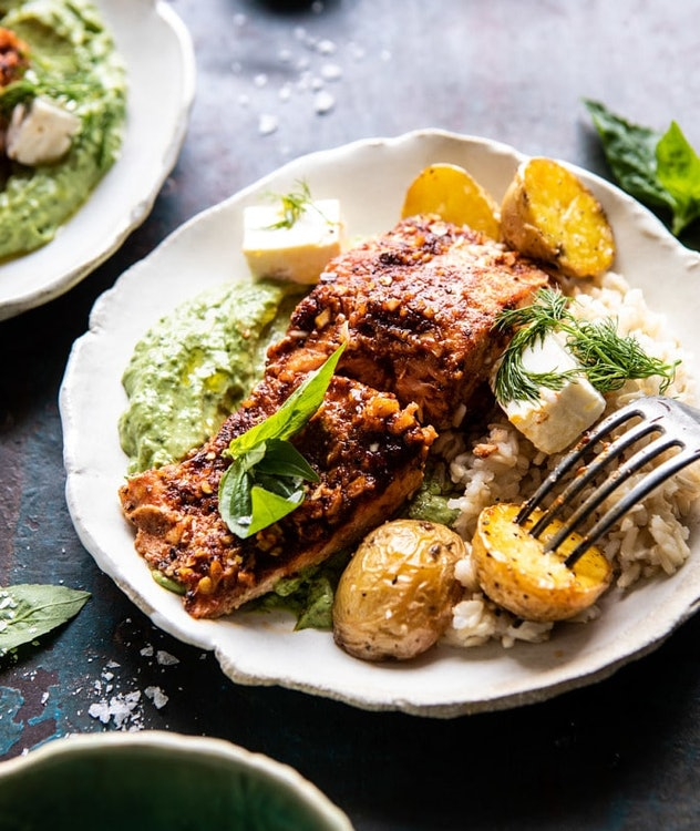 sheet pan blackened salmon bowl with potatoes and avocado goddess sauce recipe from Half Baked Harvest is a colorful and flavorful meal