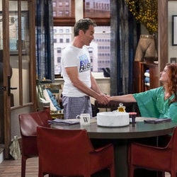 Will and Grace from 'Will & Grace' embrace.