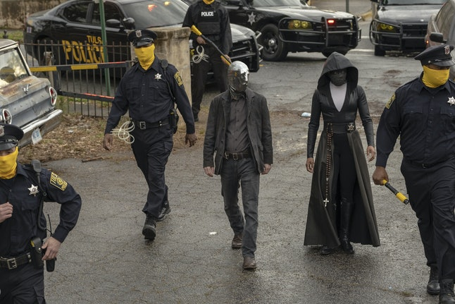 Tim Blake Nelson as Looking Glass and Regina King as Angela Abar in her Sister Night costume in HBO's Watchmen
