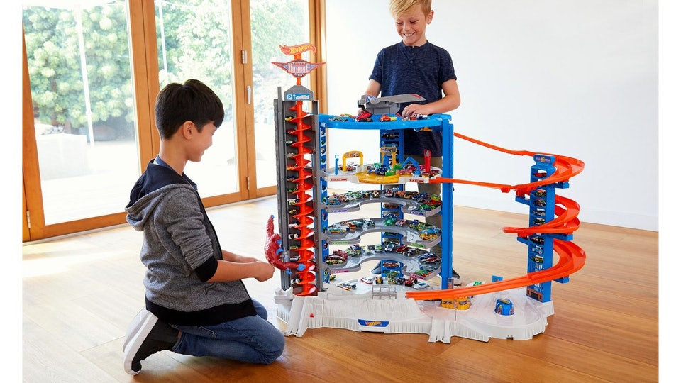 Two boys playing with Hot Wheels Ultimate Garage Playset from Target
