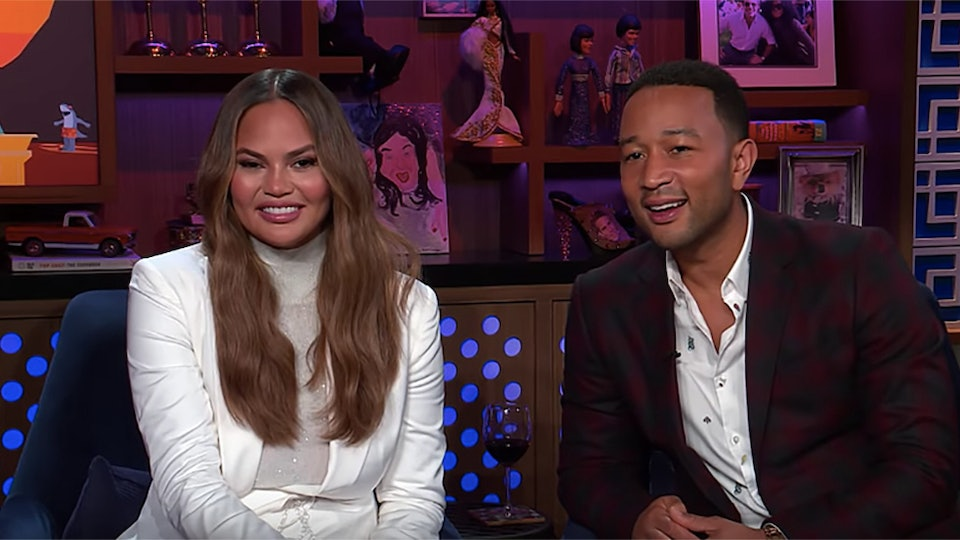 Chrissy Teigen and John Legend appear on Watch What Happens Live.