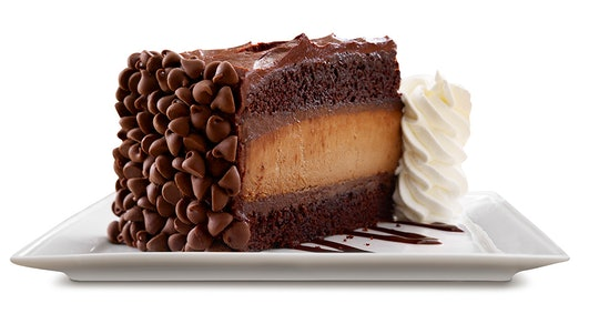 A piece of Hershey's cheesecake sits on a platter.