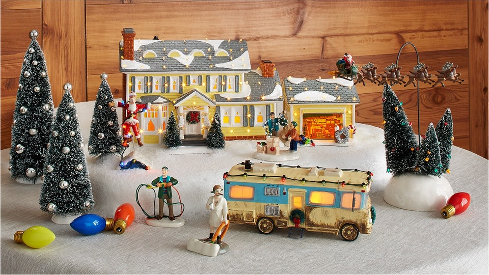 Image of National Lampoon's Christmas Vacation Village set up on faux snow background